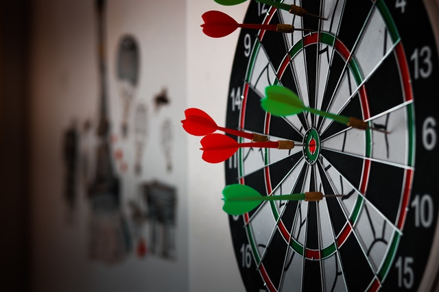 Picture of a Dart Board and some darts on it